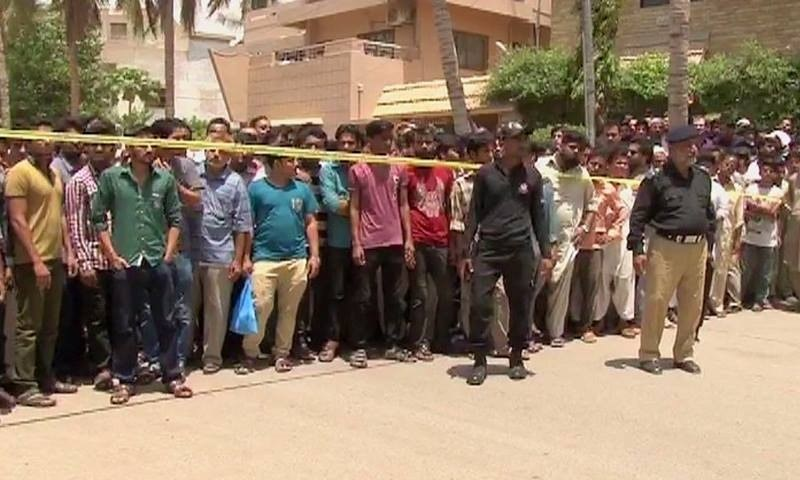 A view of the attack site in Karachi's Bahadurabad area. — DawnNews screengrab