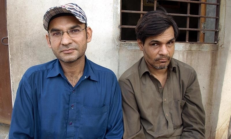Aashique Ali (left) with his friend Zafar Ali.