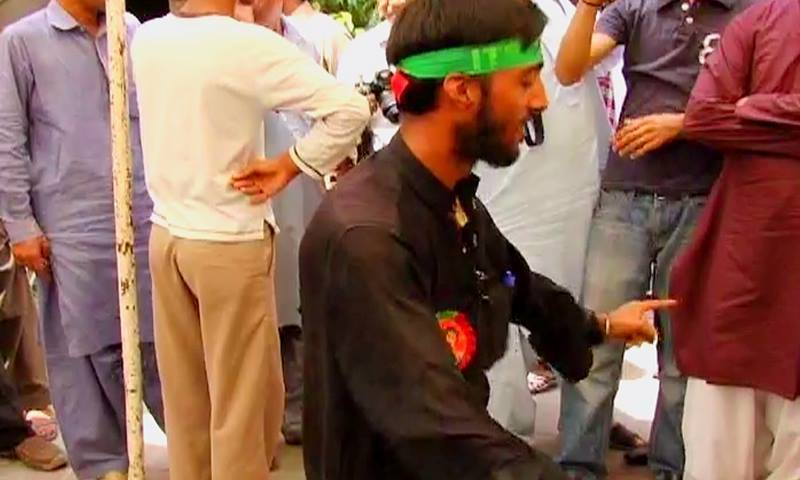 PTI supporters, gathered outside the election commission tribunal in Multan, erupted in celebrations after the verdict was announced. — DawnNews screengrab