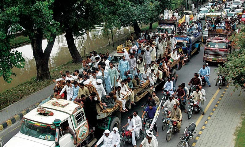 Milk suppliers and sellers stage a rally on Canal Road against the Punjab Food Authority . — Online