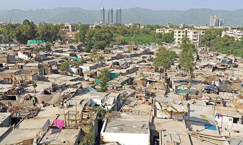Labourers who arrived in the city had to rely on informal settlements for accommodation. —Tanveer Shahzad/Dawn.com