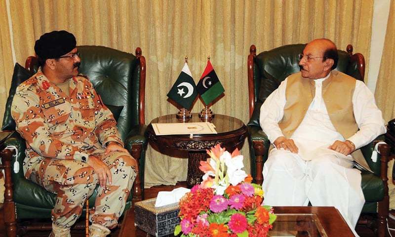 KARACHI: Chief Minister Syed Qaim Ali Shah talks to Director General of Sindh Rangers Major General Bilal Akbar who called on him at the Chief Minister House here on Friday.—Online
