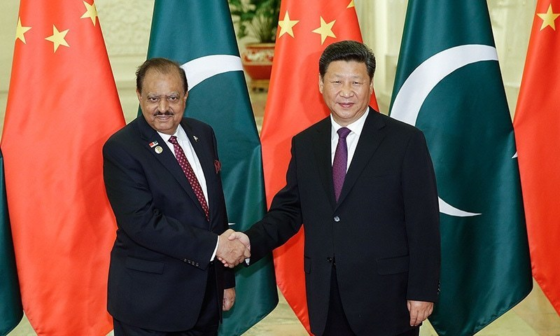China's President Xi Jinping (R) shakes hands with Pakistan's President Mamnoon Hussain (L) before their meeting at the Great Hall of the People in Beijing on September 2, 2015.  —AFP