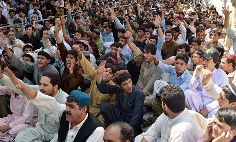 QUETTA: Traders raise slogans against withholding tax on bank transactions during a demonstration outside the press club here on Wednesday.—PPI