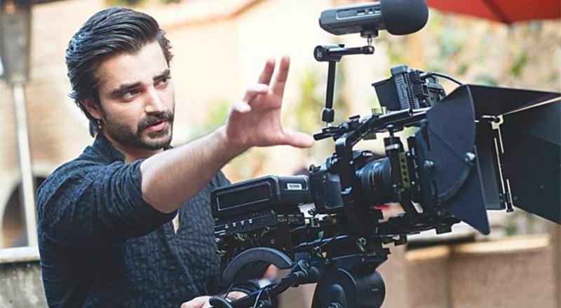 Hamza works behind the camera. —Photo courtesy: Mohammad Farooq