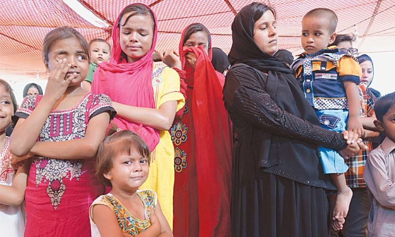 Families on Friday remember the workers who died in the Baldia garments factory at a reference held on the third anniversary of the country's deadliest fire.—White Star