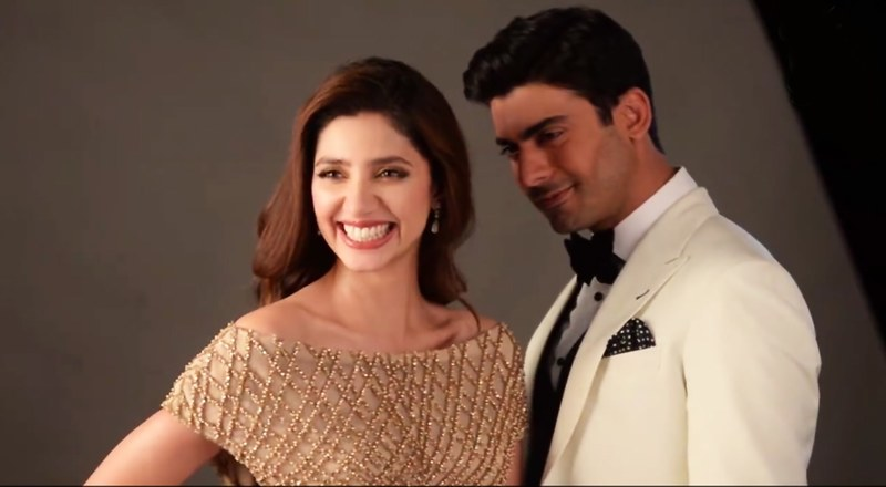 Mahira laughs as Fawad looks on in this BTS shot from the ad — Screengrab