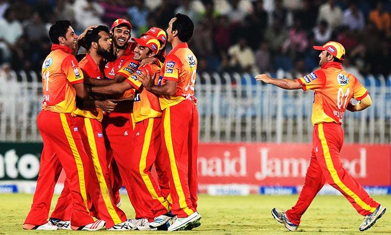 This photo taken on September 14, 2015 shows Peshawar cricketers celebrating a wicket against Sialkot during the National T20 semi-final at the Rawalpindi Cricket Stadium in Rawalpindi. — AFP