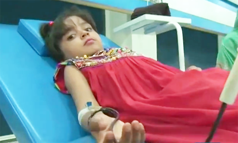 A young girl receives a blood transfusion at the centre.