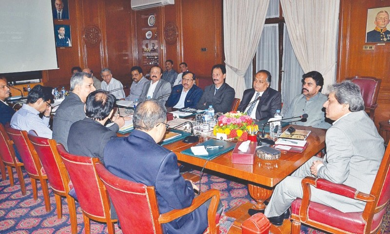 Sindh Governor Dr Ishratul Ibad Khan presides over a meeting on the Greater Karachi Sewage Treatment project at Governor House on Wednesday.—APP