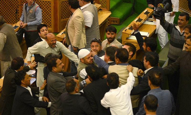 Independent lawmaker, Engineer Rashid (CL) shouts after being thrashed by Bhartiya Janta Party (BJP) legislators in the legislative assembly in Srinagar on October 8, 2015.  — AFP