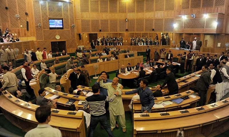 India-held Kashmir's main opposition party National Conference legislators rescue Independent lawmaker, Engineer Rashid after being thrashed by Bhartiya Janta Party (BJP) legislators in the legislative assembly in Srinagar on October 8, 2015.  — AFP