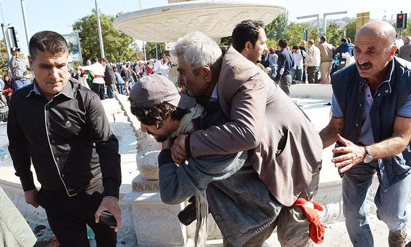 A man is carried away following an explosion at the main train station in Turkey's capital Ankara. -AFP
