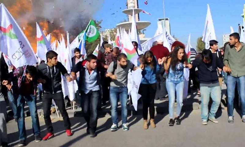 "This video grab image taken from footage made avaliable by local source ""Dokuz8 Haber"" shows the moment an explosion ripped through a gathering ahead of a planned peace rally in Ankara. -AFP"