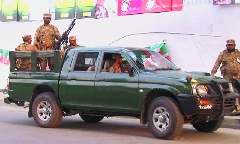 Security personnel have been deployed in Lahore and Okara to provide security at sensitive polling stations. ─ DawnNews screengrab.