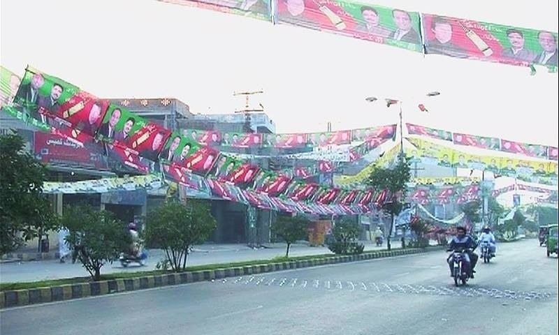 Election posters and flyers on display in Lahore. ─ DawnNews screengrab.