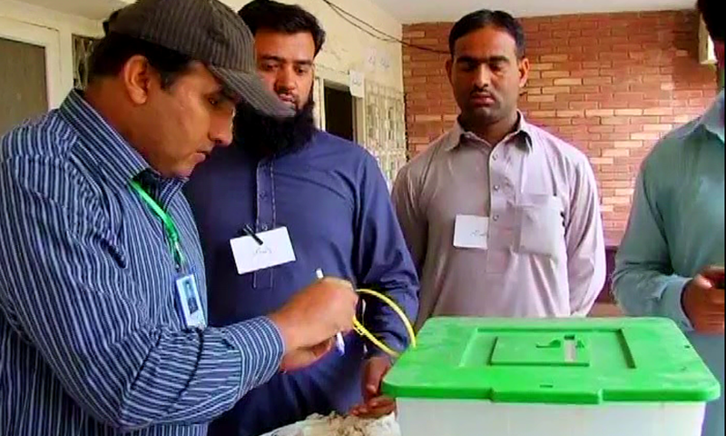 Voting under way in Okara's NA-144 constituency. ─ DawnNews screengrab.