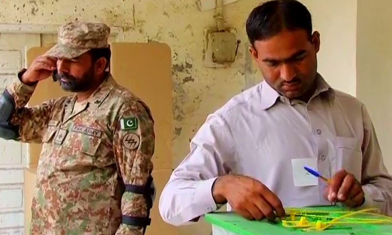 Security has been deployed at Okara's NA-144 constituency. ─ DawnNews screengrab.
