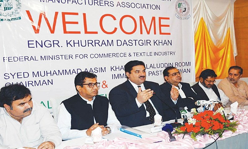 Commerce Minster Khurram Dastgir addressing a gathering of the All Pakistan Bed Sheets and Upholstery Manufacturers Association last week. Many suspect that the government does not want to announce the promised relief package without sharing it with the IMF because it includes certain initiatives that are likely to impact its budget.