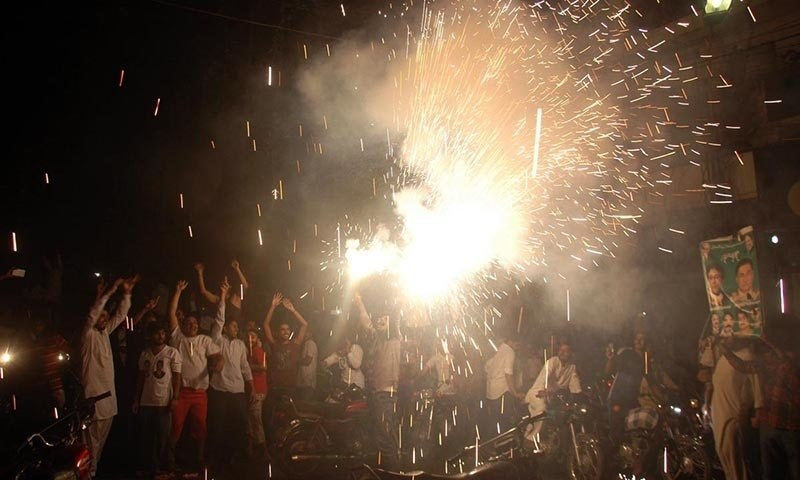 PML-N supporters celebrating Ayaz Sadiq's victory in NA-122 outside Lahore Press Club. – Online