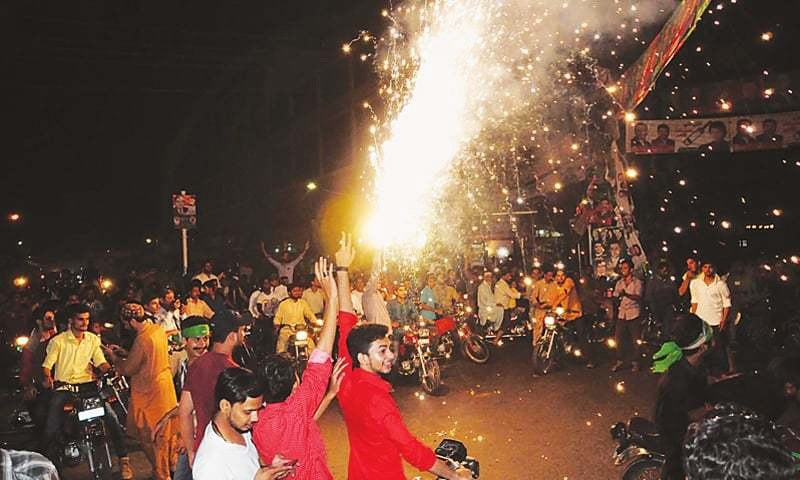 LAHORE: Activists and supporters of PML-N celebrate the victory of Ayaz Sadiq on Sunday night.—Arif Ali/White Star