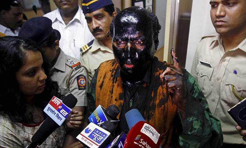 Sudheendra Kulkarni, chairman of the Observer Research Foundation Mumbai, with his face smeared with black ink, speaks to journalists in Mumbai, India, October 12, 2015. —Reuters
