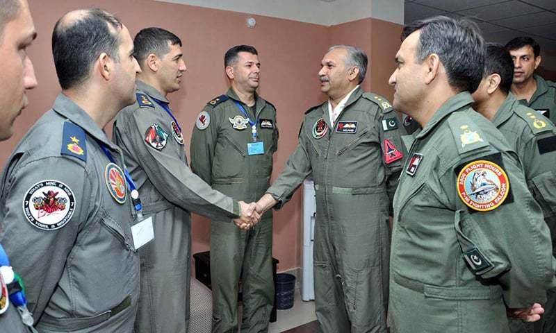 "Air Vice Marshal Mujahid Anwar Khan, Deputy Chief of the Air Staff (Operations) meeting the Turkish Air Force pilots during ""TUSAP Raiders"" at an Operational Air Base. —APP"