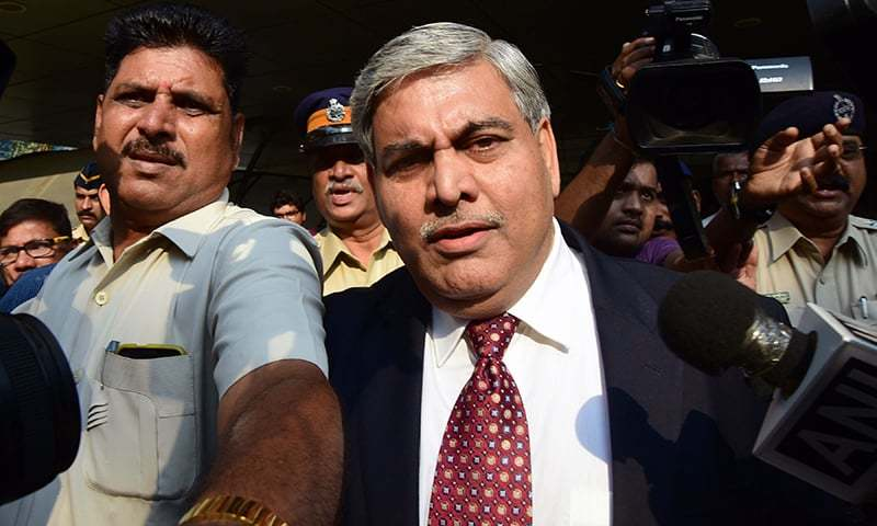 BCCI president Shashank Manohar is escorted out of the Indian cricket board's headquarters at the Wankhede stadium in Mumbai. —AFP