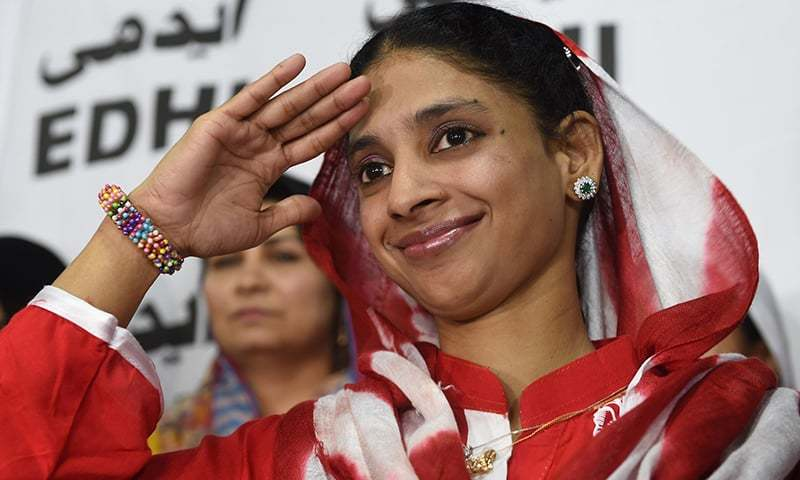Deaf-mute Indian woman Geeta salutes the media before leaving for the airport from the Edhi Foundation in Karachi. —AFP