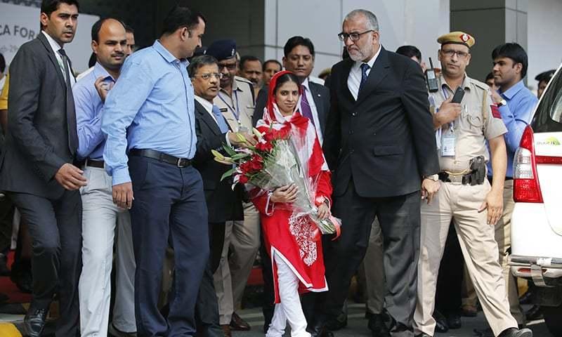 Geeta, 23, arrives at the airport in New Delhi. —AP