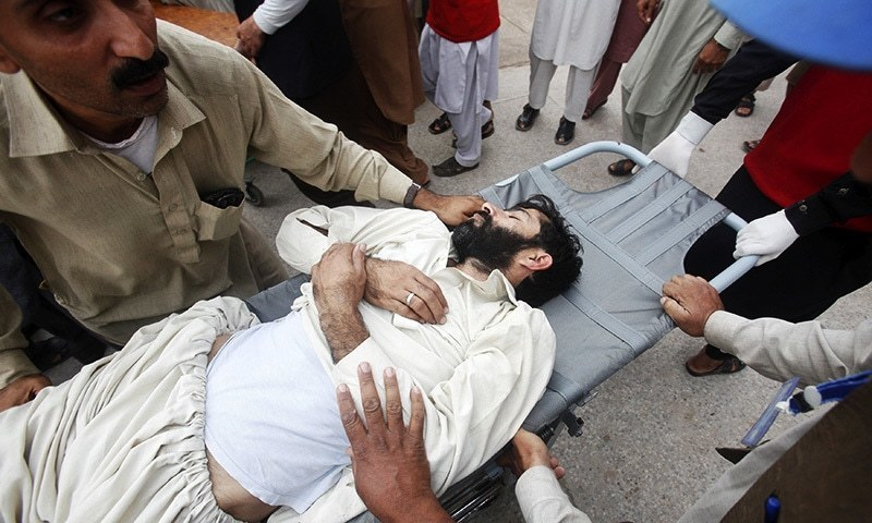 Rescue workers move a man, who was injured during an earthquake, at the Lady Reading hospital in Peshawar. -Reuters