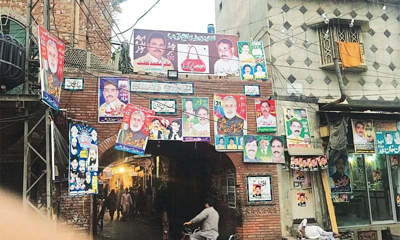 Posters of candidates participating in the first phase of local government elections in Kasur.—Photo by writer