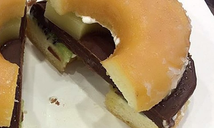 A donut cut in half with a Nutella slab, cream and kiwis in the middle? Stop the madness!