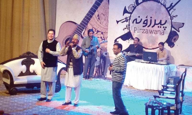A singer performs at Nishtar Hall, Peshawar. — Dawn