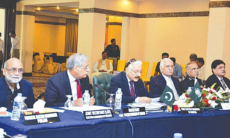 LAHORE: Chief Election Commissioner Sardar Muhammad Raza Khan addressing a meeting here on Friday.—Online