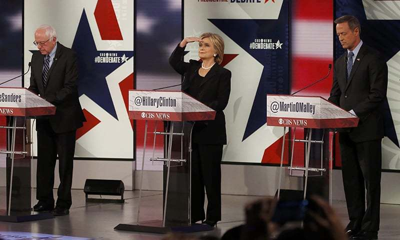 Democratic US presidential candidates Senator Bernie Sanders (L), former secretary of state Hillary Clinton and former Maryland Governor Martin O'Malley stand at their podiums ahead of the second official 2016 US Democratic presidential candidates debate. ─ Reuters
