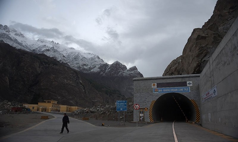 A security guard walks past the newly built tunnel in Gojal Valley. — AFP