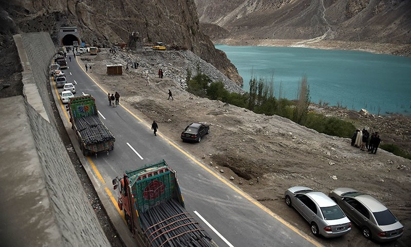 Commuters wait to travel through a newly built tunnel in Gojal Valley. — AFP