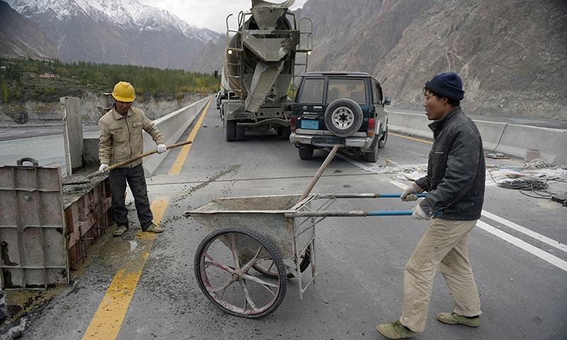 In this photograph taken on September 29, 2015, Chinese labourers work on the Karakoram highway in Gulmit village of Hunza valley. — AFP