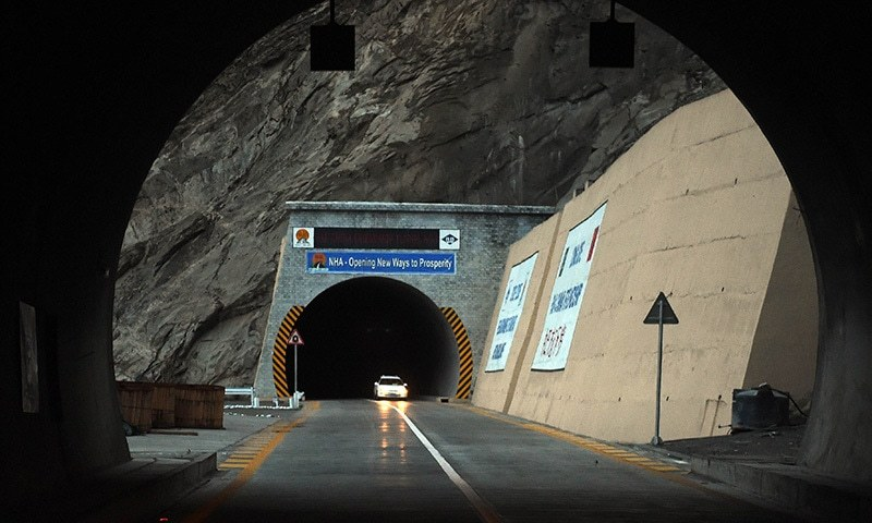 In this photograph taken on September 29, 2015, commuters travel at a newly built tunnel in northern Gojal Valley.  — AFP
