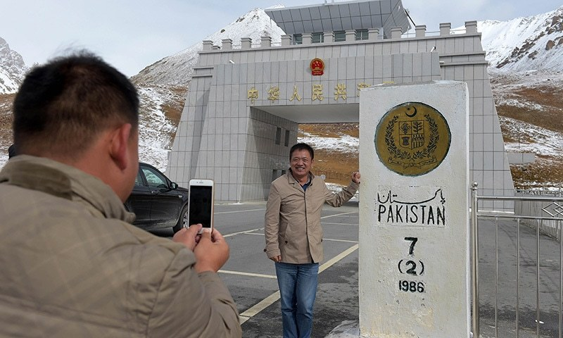 In this photograph taken on September 29, 2015, a Chinese national takes a photograph of his colleague at the Pak-China Khunjerab Pass, the world's highest paved border crossing at 4,600 metres above sea level. — AFP