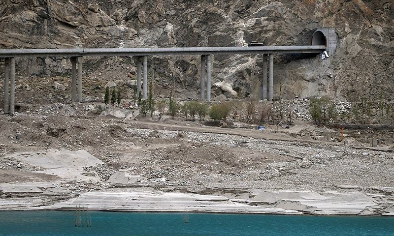 In this photograph taken on September 29, 2015, a bus carrying tourists crosses a newly built tunnel in northern Pakistan's Gojal Valley. — AFP