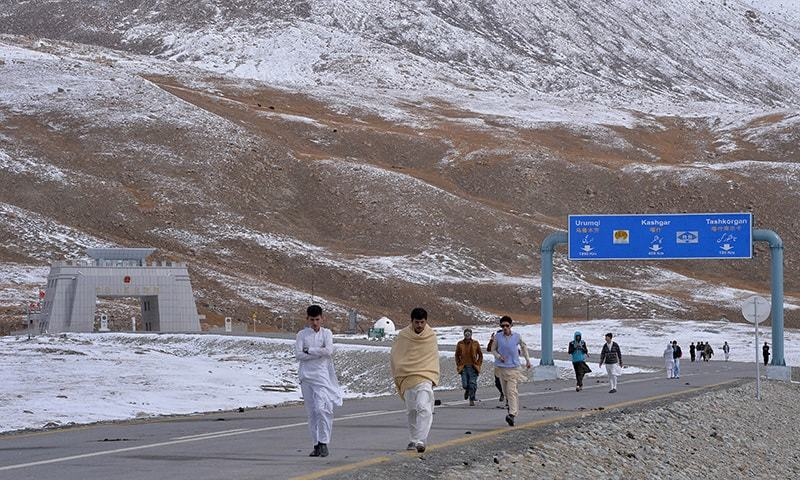 In this photograph taken on September 29, 2015, tourists leave the Pak-China Khunjerab Pass, the world's highest paved border crossing at 4,600 metres above sea level.  — AFP