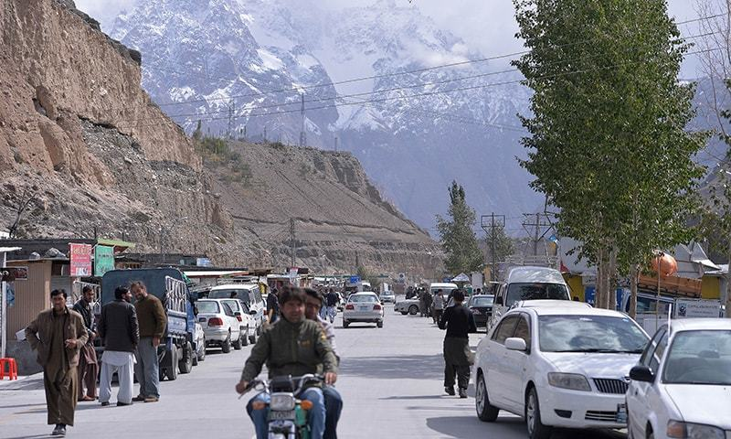 In this photograph taken on September 29, 2015, tourists and local residents go about their business at the bazaar in Sost, the border town of the Hunza valley in northern Pakistan.  — AFP