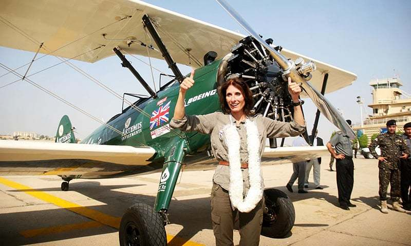 Tracey Taylor waves after landing at Quaid e Azam International Airport. —Online