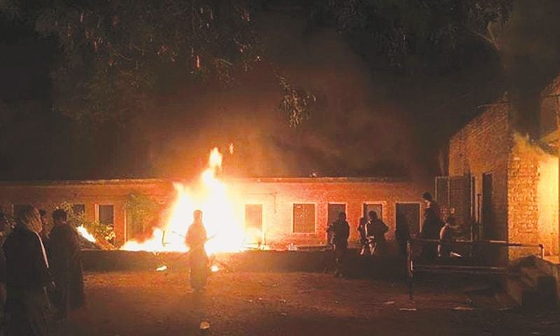 JHELUM: Protesters torch the factory after one of its employees was accused of committing blasphemy.—AFP
