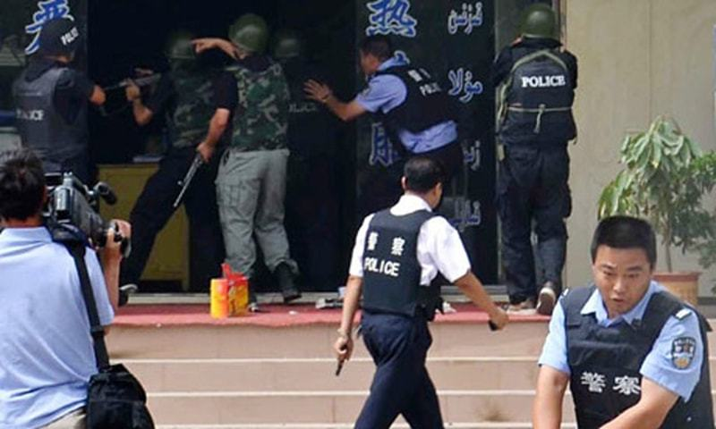 """The PLA Daily said the special forces used flash grenades and tear gas to force the attackers out of hiding, but when those methods failed, a senior officer said: """"Use the flamethrower."""" — AP/File"""