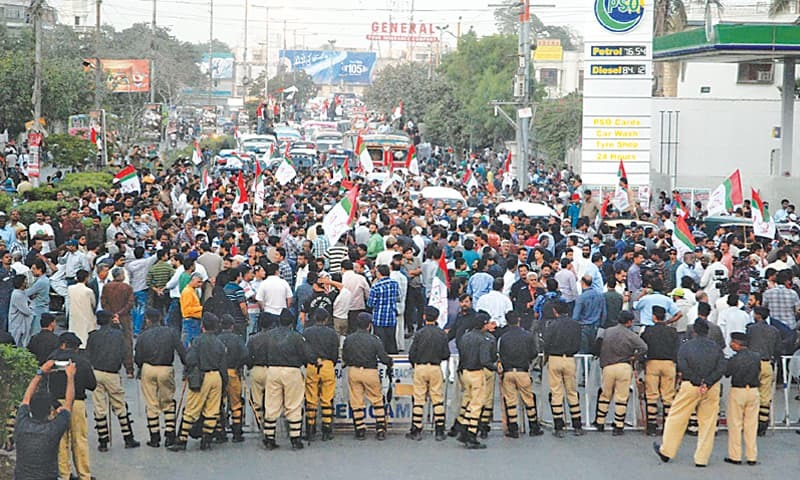 Workers of the Muttahida Qaumi Movement on Thursday stage a protest rally on M.A. Jinnah Road against the Rangers over the detention of party activists in recent raids on party election camps.—PPI