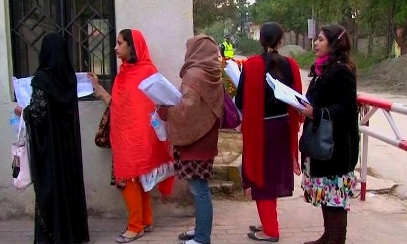 Women lining up at a polling station to cast their votes. ─ DawnNews screengrab