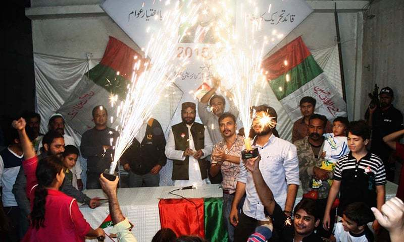 MQM workers and supporters celebrate in Federal B Area, Karachi. —Online